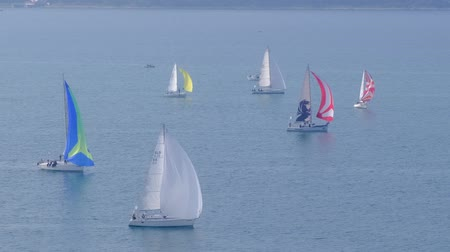 Portoroz, Slovenia - Oct 12 2019: Sailing boats sail from Portoroz towards gulf of Trieste, Italy to participate at Barcolana 2019 regatta