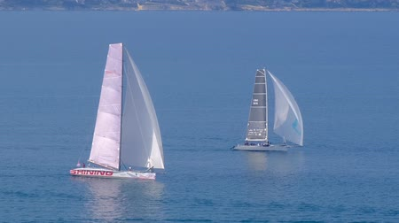 vessels : Portoroz, Slovenia - Oct 12 2019: Sailing boats sail from Portoroz towards gulf of Trieste, Italy to participate at Barcolana 2019 regatta
