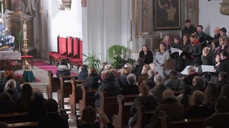 kostel : Slovenska Bistrica, Slovenia - Dec 25 2019: Church choir sings Christmas carols during service in Catholic church in Slovenska Bistrica, Slovenia