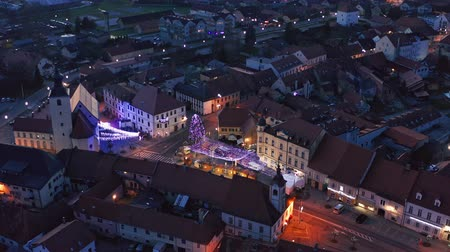 historical : Slovenska Bistrica, Slovenia - Dec 25 2019: Aerial view of Christmas fair on main square in Slovenska Bistrica, a small medieval town in Slovenia with wooden shop stands, closed on Christmas eve