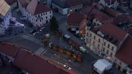 histórico : Slovenska Bistrica, Slovenia - Dec 25 2019: Closed shops on Christmas day on main square fair in Slovenska Bistrica, SLovenia, aerial view