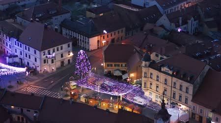 Slovenska Bistrica, Slovenia - Dec 25 2019: Aerial view of Christmas fair on main square in Slovenska Bistrica, a small medieval town in Slovenia with wooden shop stands, closed on Christmas eve
