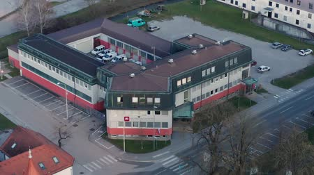 szállító : Slovenska Bistrica, Slovenia - Dec 25 2019: Elektro Maribor branch office in Slovenska Bistrica, aerial view of electricity power supply and grid maintenace company in Slovenia