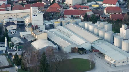 照らさ : Slovenska Bistrica, Slovenia - Dec 25 2019: Aerial view of Gea Oil Mill in Slovenska Bistrica, Slovenia 動画素材