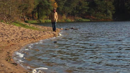 felvidéki : a man walks along the lake shore in autumn