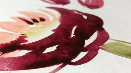 bleed : Beautiful watercolor ink drops on white paper. Artists paint with a brush, flowers on paper Stock Footage