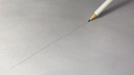 exercício : Artists hands drawing wooden pencil writes line on paper.