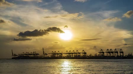 tárolás : Singapore Port Timelapse Sunset,  import and export shipping harbor. day to night Stock mozgókép