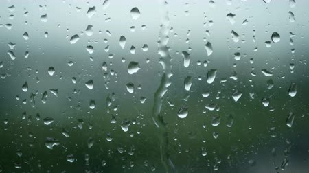 Łzy : 4K. rain running up on window surface. rain drop in rainy day Wideo