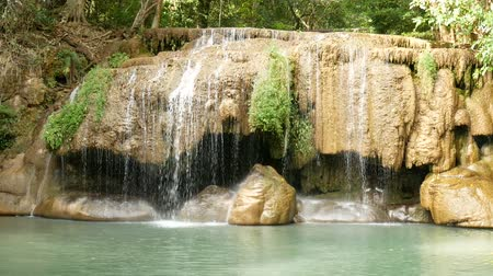 külföldi : Erawan waterfall , popular famous tourist attraction in Kanchanaburi, Thailand. Erawan waterfall is a waterfall in tropical rain forest, popular with both Thai and foreign tourists.
