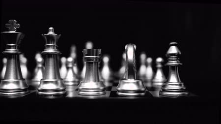 white elephant : 4K. chessboard and chess pieces dolly video slider with black and white color. chess game footage background.
