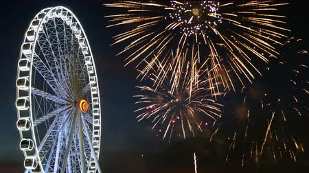 asma : 4K footage of giant ferris wheel with colorful firework festival in the sky for celebration at night background Stok Video
