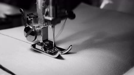 makineleri : 4K footage. close up of sewing machine needle on white fabric with slow motion , black and white color Stok Video