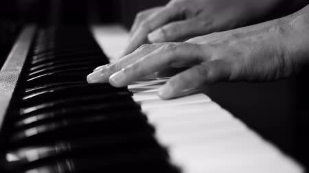 sonata : 4K footage of piano music pianist hands playing monochrome black and white color. musical instrument grand piano selective focus with depth of field