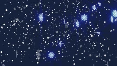 New Year background with falling snowflakes. Snowfall on blue background.