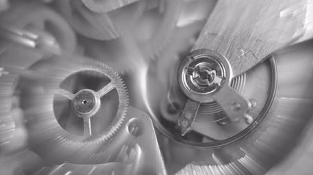 obsoleto : Black and white Background with metal cogwheels clockwork mechanism and numbers, Countdown, abstract sun beams, Concept Movement is life, Teamwork, Idea Technology, Infinity. Macro.