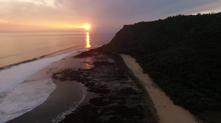 mag : Aerial View of Sunrise at Nyang-Nyang Beach, Bali Stock mozgókép