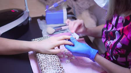 rasp : Finger nail treatment, grinding and polishing in beauty salon. Manicure process in beauty salon, close up. Manicurist Hands Make Female Manicure With Nail Clippers In The Nail Salon.