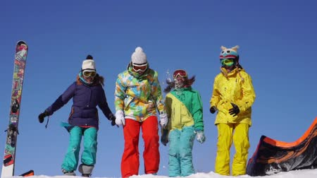 snowboard : Four young people beautiful have fun of the snow mountain Stok Video