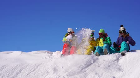 snowboard : Cheerful rest with friends in ski resort. Young girls I ride on snow from mountain top.