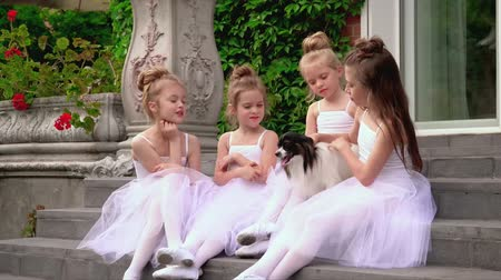 balerína : Little schoolgirls of ballet school sit on a porch of school