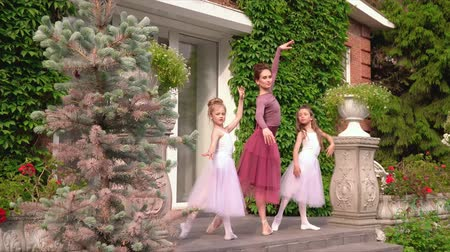 tüt : Little ballerinas pose on a porch of school for the photo