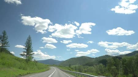 межгосударственный : The highway in the mountain area. Movement of the camera. 4K. Sky and clouds.