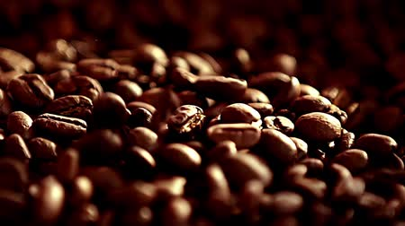 cheerfulness : Coffee beans rotation in the slowed-down movement macro.