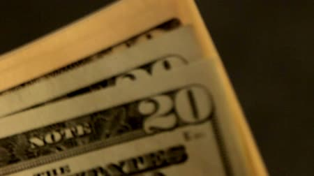 one hundred : Dollar banknotes. Close up. George Washingtons portrait on banknotes in hundred dollars. Recounting of dollar banknotes. Stock Footage