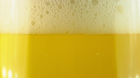taberna : Cold Light Beer in a glass with water drops. Craft Beer close up. Rotation 360 degrees. 4K UHD video 3840x2160.There are no people. Stock Footage