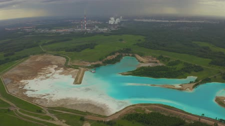 gushing : Artificial lake for discharging chemical waste from a chemical plant. Environmental pollution. Ecological catastrophy. Aerial shot 4K. Stock Footage