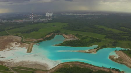 produtos químicos : Artificial lake for discharging chemical waste from a chemical plant. Environmental pollution. Ecological catastrophy. Aerial shot 4K. Stock Footage