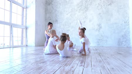 fegyelem : Ballet School. Small ballerinas learn to dance. Beautiful view. Stock mozgókép