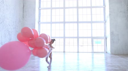 規律 : Ballet School. Little ballerina dancing with pink balls.