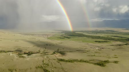 fenomen : aerial view of rainbow in the mountains, flying in a rainbow in the rain, aerial view of Rainbow in mountain landscape, Rainbow in the Mountains and Dramatic Mountain Clouds After the Rain