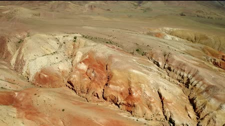 desert life : Colored rocks . Flying over red rock formation in Southern mountains. Aerial shot, 4K.