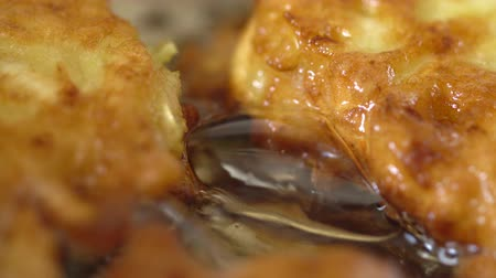 american cuisine : View footage of frying fritters in boiling hot oil