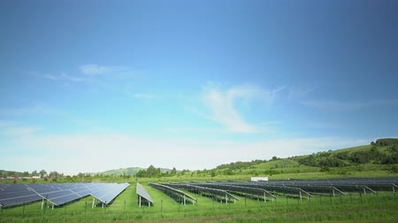photovoltaic : Solar panels in a mountainous area near the road. Around the fence with barbed wire. Modern technologies.