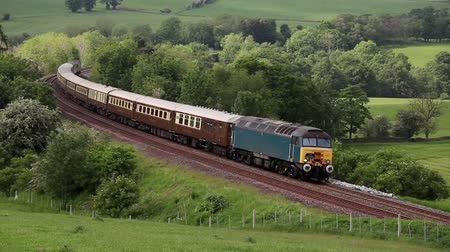 pictured : The rail tour The Cumbrian Moorlander is pictured on the Settle to Carlisle railway heading south through Armathwaite, Cumbria. Stock Footage