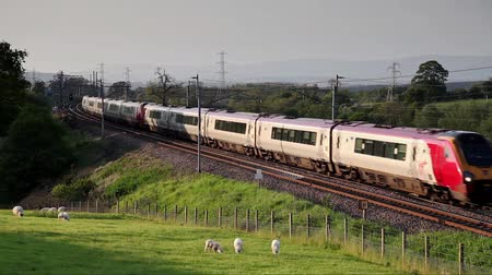 voyager : A Virgin Super Voyager heads south through Hackthorpe, Cumbria.  Virgin trains have operated the UK west coast main line rail franchise since 1987. Stock Footage