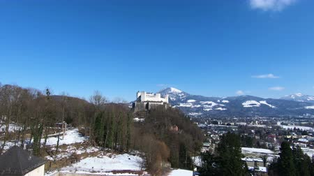 avusturya : Salzburg Castle and Landscape. A view of Salzburg Castle in Austria and its surrounding landscape on a winter day. Stok Video