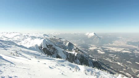 snowcapped : Untersberg Mountain View. The view from a snow capped Untersberg mountain in Austria. The mountain straddles the border between Germany and Austria.