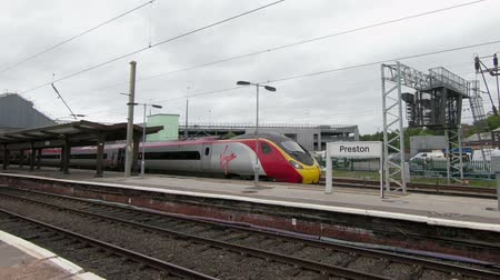 departing : A Virgin Pendolino train is seen departing Preston Station, Lancashire, on the English west coast mainline.