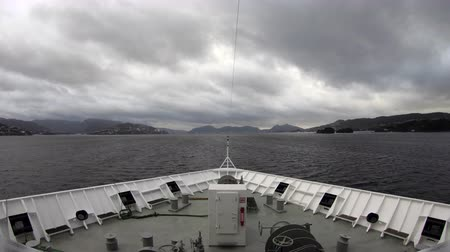 Скандинавия : Bergen Fjord.  A timelapse recording looking over the bow of a ship travelling through Bergen fjord in Norway. Стоковые видеозаписи
