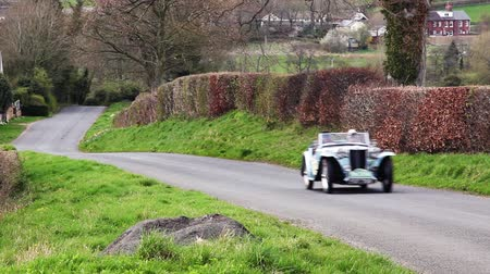 mg : A 1948 MG TC climbs Southwaite Hill in Cumbria, England.  The car is taking part in the 11th Flying Scotsman Rally, a free public-event.