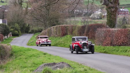 veteran's day : A 1934 Lagonda 1680 and 1939 Buick Century 66S climb Southwaite Hill in Cumbria, England.