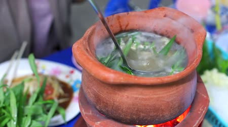 kamenina : Girl fill Vegetable in Clay Pot to make Thai Hot Pot Street Food (Jim Jum), Thai Food