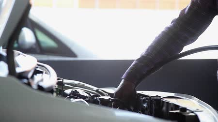wrench : Hand of Auto Mechanic Clear and Cleaning the Engine with Blower at the Garage Stock Footage