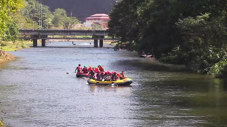 gát : NAKHON NAYOK, THAILAND - JANUARY 1, 2018: Two Boats with Group of Young People Rafting on the River at Khun Dan Prakan Chon Dam, Popular Touristic Destination for Rafting in NAKHON NAYOK