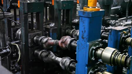 metalurgia : Machine Tools Metal Factory. This is a small video footage of metal products. The video is perfect for projects with themes of factory, metal rolling, metallurgy, manufactory, machinery, work, industry. manufacture of iron pipe, cardan shaft, etc